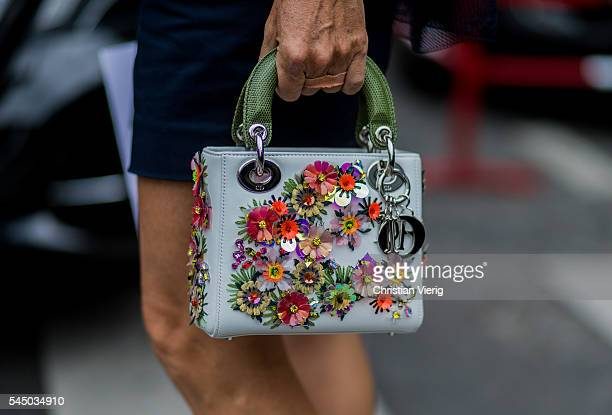 Dior bag outside Dior during Paris Fashion Week Haute Couture F/W 2016/2017 on July 4, 2016 in Paris, France.