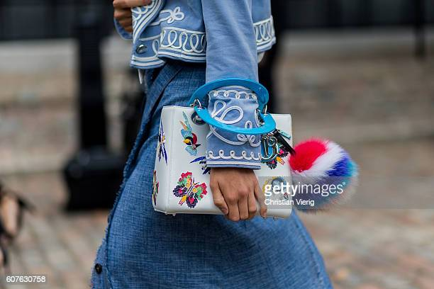 Dior bag with Fendi fur ball outside Preen during London Fashion Week Spring/Summer collections 2017 on September 18 2016 in London United Kingdom