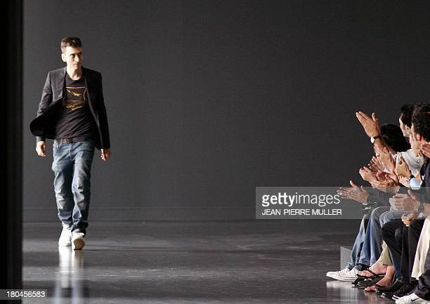 Dior designer Hedi Slimane salutes during his Spring/Summer 2005 men's ready to wear show 05 July 2004 during Paris fashion week