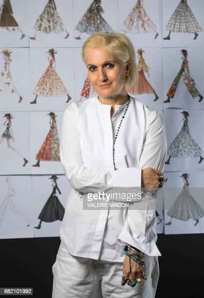 Dior designer Maria Grazia Chiuri poses infront of her designs on May 10 in Los Angeles California / AFP PHOTO / VALERIE MACON