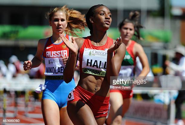 Dior Hall of USA claps her hands after winning her heat in the women's 100m hurdles during day four of the IAAF World Junior Championships at Hayward...