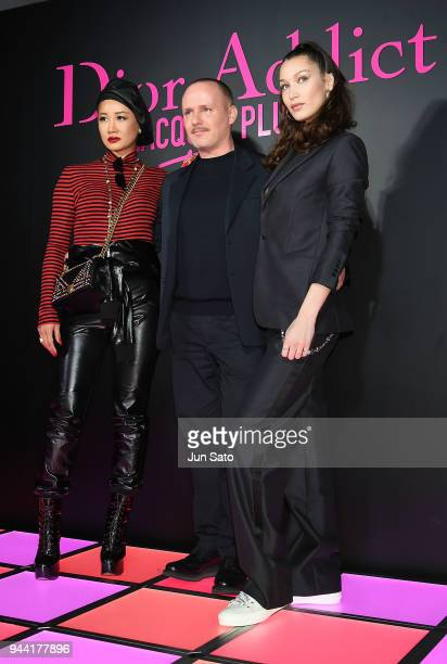 Dior Homme's new jewelry designer Yoon Ahn Bella Hadid Dior creative imaging director Peter Phillips attend the Dior Addict Lacquer Plump Party at 1...