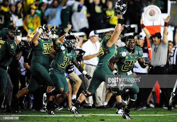 Dior Mathis and Kenjon Barner of the Oregon Ducks run out on the field after the Ducks defeated the Wisconsin Badgers 45-38 at the 98th Rose Bowl...