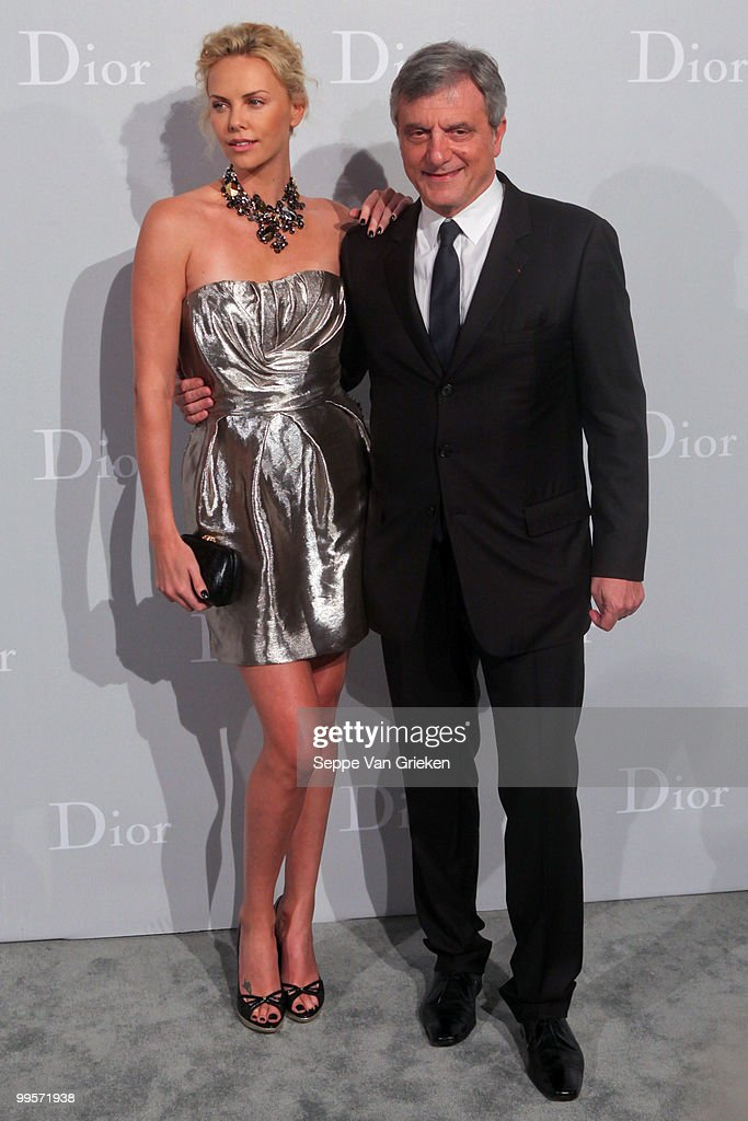 Dior president Sidney Toledano and actress Charlize Theron pose for a photograph at the entrance of the Dior Cruise 2011 fashion show on May 15, 2010 in Shanghai, China.
