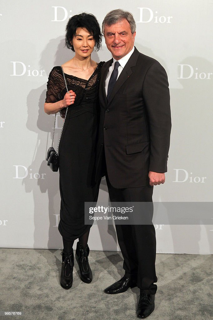 Dior president Sidney Toledano and actress Maggie Cheung pose for a photograph at the entrance of the Dior Cruise 2011 fashion show on May 15, 2010 in Shanghai, China.