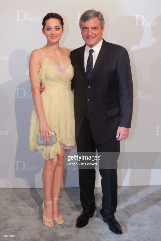 Dior president Sidney Toledano and actress Marion Cotillard pose for a photograph at the entrance of the Dior Cruise 2011 fashion show on May 15, 2010 in Shanghai, China.