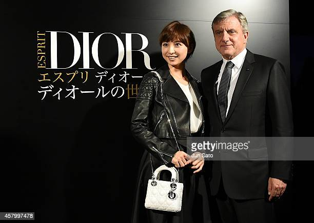 CEO Dior Sidney Toledano and actress Mariko Shinoda arrive at the 'Esprit Dior' Opening Reception on October 28 2014 in Tokyo Japan