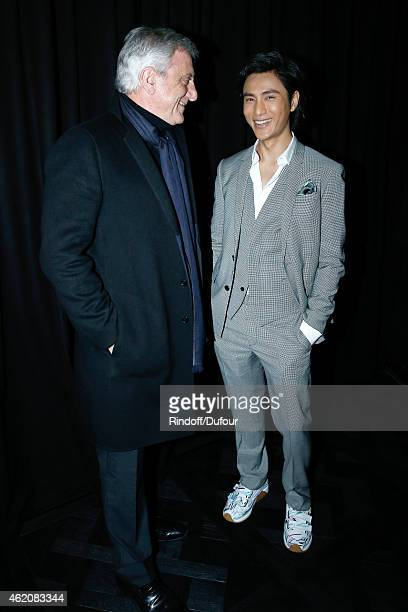 CEO Dior Sidney Toledano and Chen Kun attend the Dior Homme Menswear Fall/Winter 20152016 Show as part of Paris Fashion Week on January 24 2015 in...