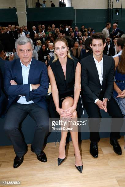 Dior Sidney Toledano, Candice Swanepoel and Pierre Niney attend the Dior Homme show as part of the Paris Fashion Week Menswear Spring/Summer 2015 on...