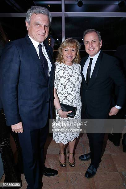 Dior Sidney Toledano, Chairman and Chief Executive Officer of Louis Vuitton, Michael Burke and his wife Brigitte attend the Sidaction Gala Dinner...