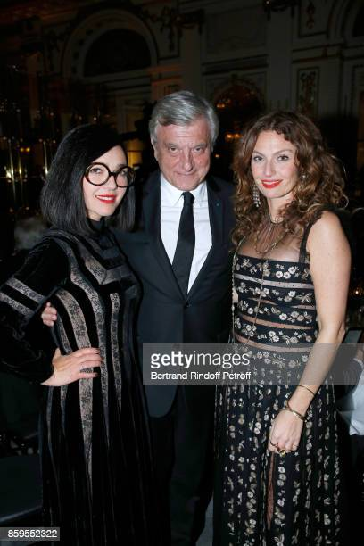 Dior Sidney Toledano standing between Members of Musical Group 'Brigitte' Aurelie Saada and Sylvie Hoarau attend the 'Diner des Amis de Care' at...