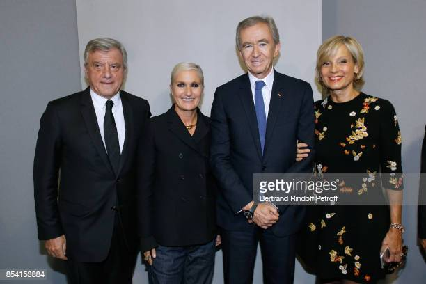 CEO Dior Sidney Toledano Stylist Maria Grazia Chiuri Owner of LVMH Luxury Group Bernard Arnault and his wife Helene MercierArnault pose backstage...