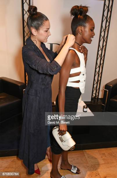 Dior spokesmodel Bella Hadid and Leomie Anderson celebrate the launch of Bella's new Dior Pump 'N' Volume Mascara at Selfridges on April 20 2017 in...