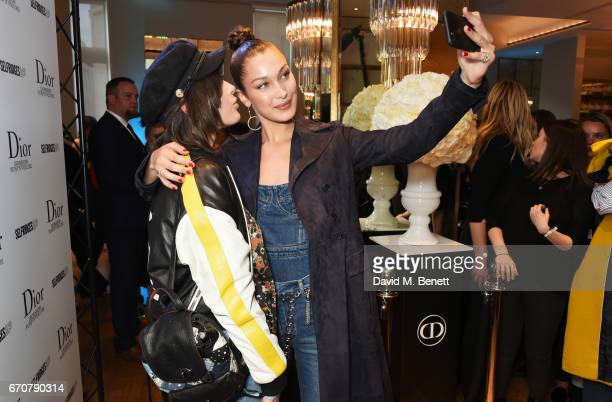 Dior spokesmodel Bella Hadid meets a fan as she celebrates the launch of her new Dior Pump 'N' Volume Mascara at Selfridges on April 20 2017 in...