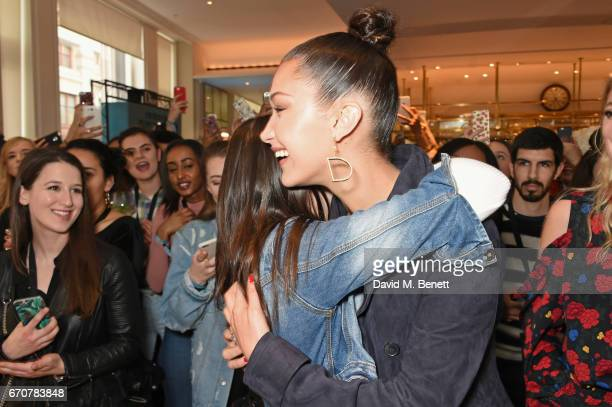Dior spokesmodel Bella Hadid meets fans as she celebrates the launch of her new Dior Pump 'N' Volume Mascara at Selfridges on April 20 2017 in London...