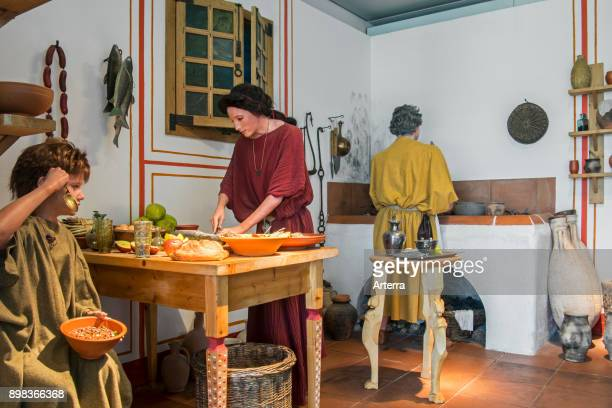 Diorama showing lifesize figures depicting daily life in the kitchen of a Roman villa Echternach Luxembourg