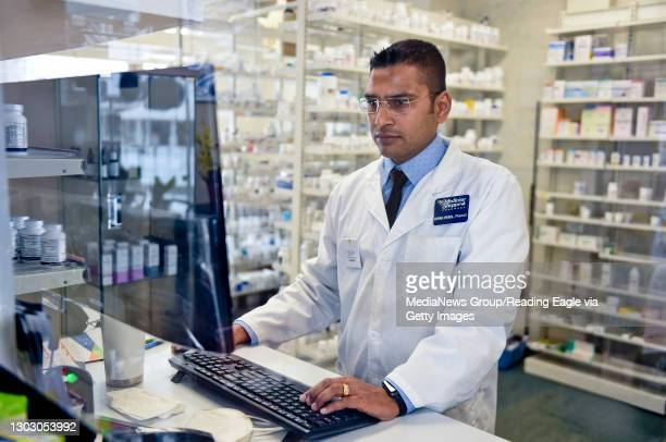 Dipak Patel, the pharmacist and owner of The Medicine Shoppe works behind the counter of the pharmacy in Shillington Friday morning February 19, 2021.