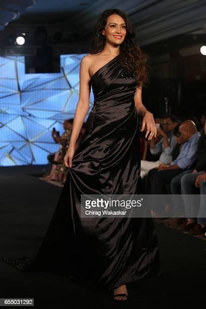 Dipannita Sharma walks the runway at the Nidhi Munim show during India Intimate Fashion Week 2017 at Hotel Leela on March 18 2017 in Mumbai India