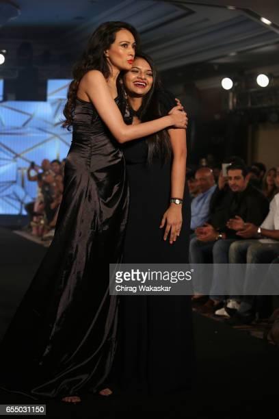 Dipannita Sharma walks the runway with Nidhi Munim during India Intimate Fashion Week 2017 at Hotel Leela on March 18 2017 in Mumbai India