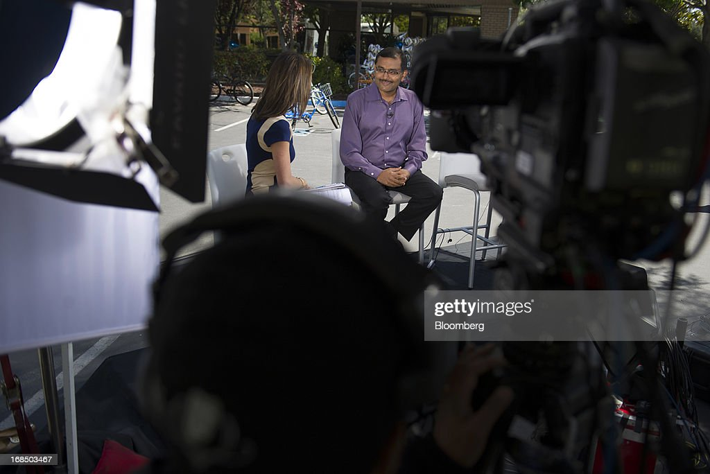 Dipchand 'Deep' Nishar, senior vice president products at LinkedIn Corp., right, speaks with Bloomberg West anchor Emily Chang during a Bloomberg West television interview outside of the company's headquarters in Mountain View, California, U.S., on Thursday, May 9, 2013. The business-oriented network, which is celebrating its 10th anniversary, reported that revenue for the first-quarter of 2103 was $324.7 million, up from $188.5 million in the first quarter of 2012. Photographer: David Paul Morris/Bloomberg via Getty Images