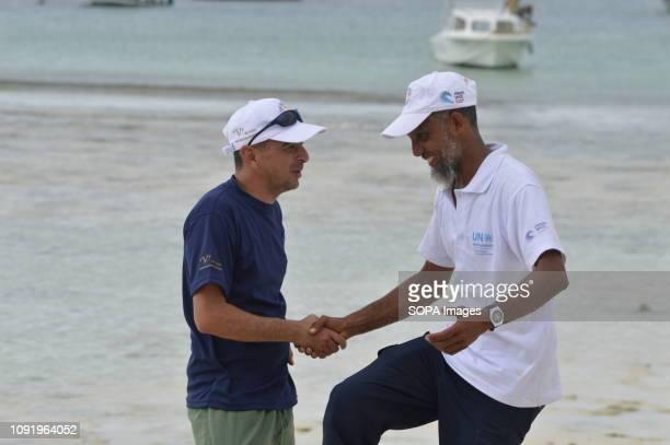 Dipesh Pabari FlipFlopi boat cofounder seen chatting with Ali Skanda the boat builder in Watamu Kenya before starting the 'Zanzibar' expedition The...