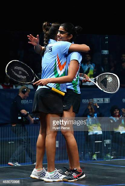 Dipika Pallikal and Joshana Chinappa of India celebrate victory over Laura Massaro and Jenny Duncalf of England during the Squash Women's Doubles...