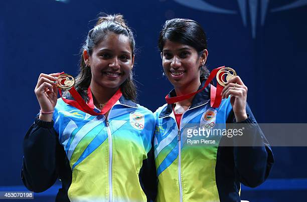 Dipika Pallikal and Joshana Chinappa of India celebrate with their Gold medals after the Squash Women's Doubles Final at Scotstoun Sports Campus...