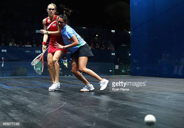 Dipika Pallikal of India is blocked by Laura Massaro of England during the Squash Women's Doubles Final between England and India at Scotstoun Sports...