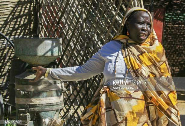 A diplaced Sudanese woman is pictured outside her hut at the Abu Shouk camp for internally displaced persons nearly 20 kms north of ElFasher the...