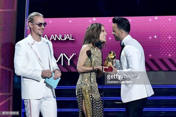 Diplo and Debi Nova present the Record of the Year award for 'Despacito' to Luis Fonsi onstage during The 18th Annual Latin Grammy Awards at MGM...