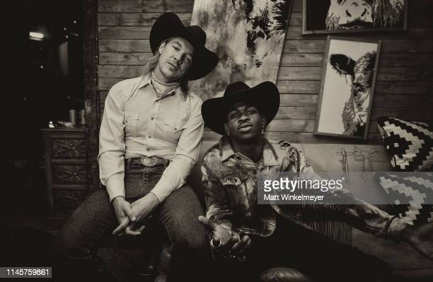 Diplo and Lil Nas X pose backstage during the 2019 Stagecoach Festival at Empire Polo Field on April 28 2019 in Indio California