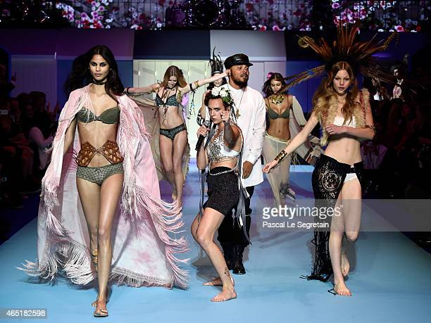 Diplo and Major Lazer perform on the runway during the ETAM show as part of the Paris Fashion Week Womenswear Fall/Winter 2015/2016 at Piscine...