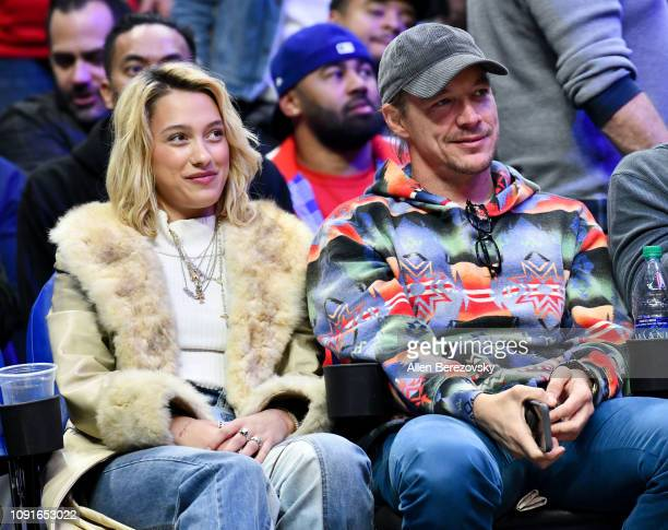 Diplo and Michaela Watson attend a basketball game between the Los Angeles Clippers and the Charlotte Hornets at Staples Center on January 08 2019 in...