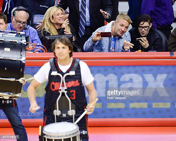 Diplo and Skrillex attend a basketball game between the Phoenix Suns and the Los Angeles Clippers at Staples Center on March 10 2014 in Los Angeles...
