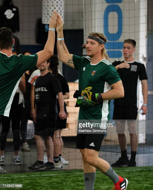 Diplo celebrates during the Copa Del Rave Charity Soccer Tournament at Evolve Project LA on April 17 2019 in Los Angeles California