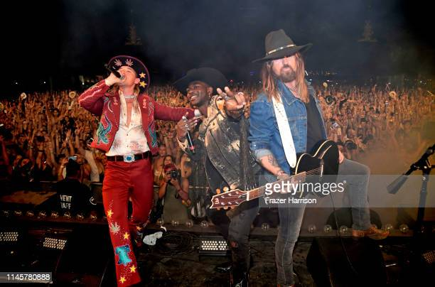 Diplo Lil Nas X and Billy Ray Cyrus perform onstage during the 2019 Stagecoach Festival at Empire Polo Field on April 28 2019 in Indio California