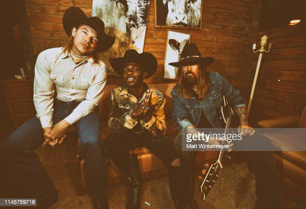 Diplo Lil Nas X and Billy Ray Cyrus pose backstage during the 2019 Stagecoach Festival at Empire Polo Field on April 28 2019 in Indio California