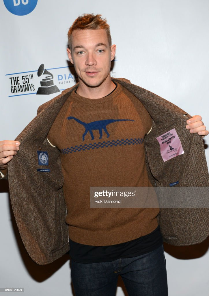 DJ Diplo poses backstage at the GRAMMYs Dial Global Radio Remotes during The 55th Annual GRAMMY Awards at the STAPLES Center on February 7, 2013 in Los Angeles, California.