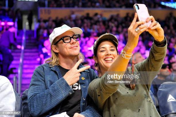 Diplo poses for a selfie with a fan during a basketball game between the Los Angeles Lakers and the Sacramento Kings at Staples Center on March 24...