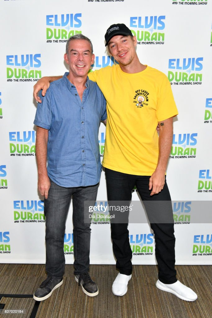 Diplo (R) poses with Elvis Duran during his visit to 'The Elvis Duran Z100 Morning Show' at Z100 Studio on August 22, 2017 in New York City.