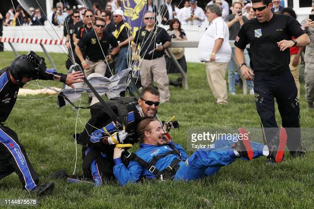 Diplo skydives onto the Preakness finish line with the United States Navy Parachute Team at the 2019 InfieldFest during the 144th Preakness Stakes...