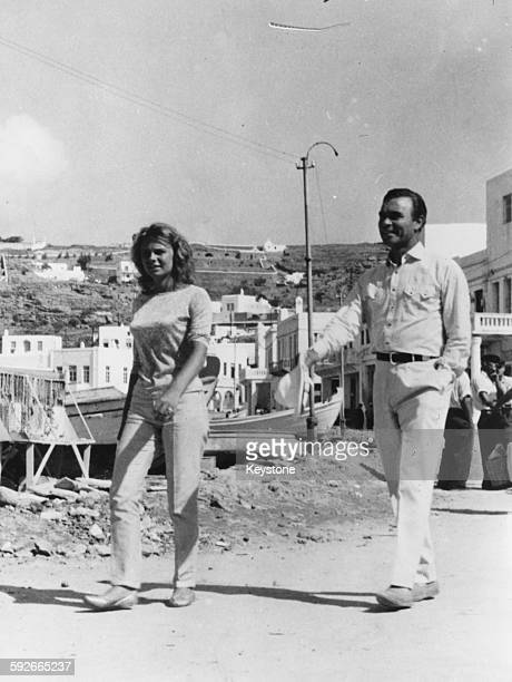 Diplomat and racing driver Porfirio Rubirosa and his wife Odile Rodin on holiday in Mycanos circa 1960