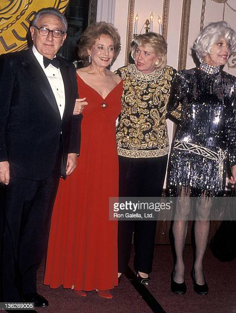 Diplomat Henry Kissinger, TV journalist Barbara Walters, gossip columnist Liz Smith and actress Carol Channing attend the New York Friars' Club...