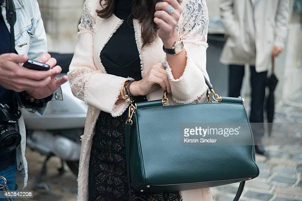 Diplomat Ulkar Panahzade wearing a Chanel coat Dolce and Gabbana bag and Roland Mouret dress day 5 of Paris Haute Couture Fashion Week Autumn/Winter...