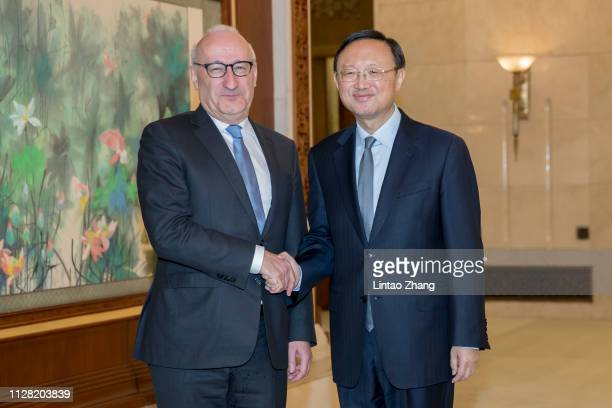 Diplomatic advisors of French President Philippe Etienne shakes hands with Director of the Office of the Foreign Affairs Commission of the CPC...