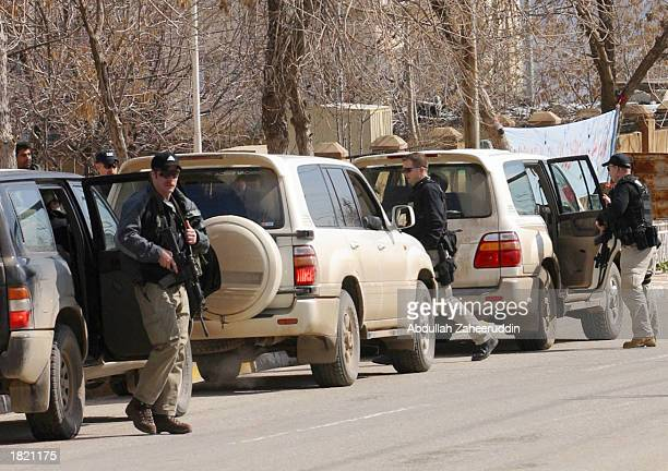 S Diplomatic Security Service members stand guard outside as diplomats arrive for a meeting of the Iraqi opposition leaders February 28 2003 in...
