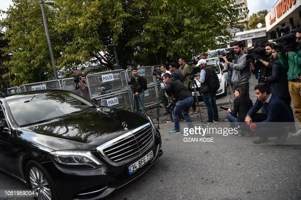 A diplomatic vehicle drives past journalists while leaving the Saudi Arabian consulate in Istanbul on October 12 2018 A Saudi delegation arrived in...
