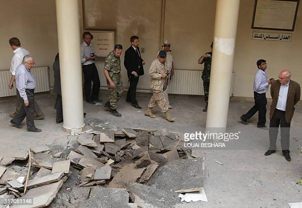 Diplomats and journalists based in Syria visit the damaged Justice Palace in the northern Syrian town of Jisr alShughur 325 kms northwest Damascus as...