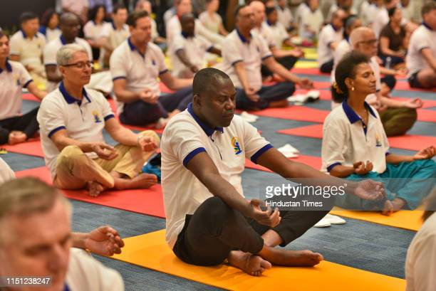 Diplomats of different countries participate during the 5th International Yoga Day celebrations at Pravasi Bharatiya Kendra on June 21 2019 in New...