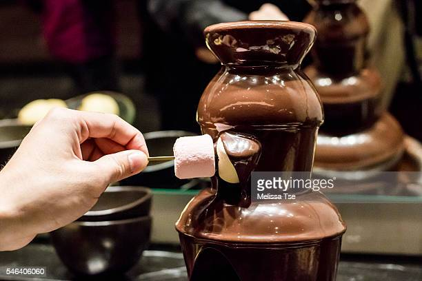 Dipping Marshmallow in Chocolate Fountain